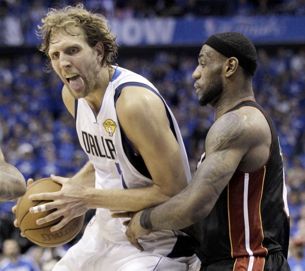 Nowitzki (esq) e LeBron James - dois dos profissionais mais mediáticos que defenderam a redução de jogos da época regular Fonte:  media.oregonlive.com/